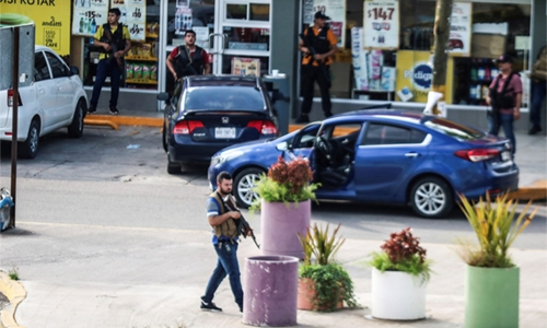 Cartel gunmen chase away forces, free El Chapo's son