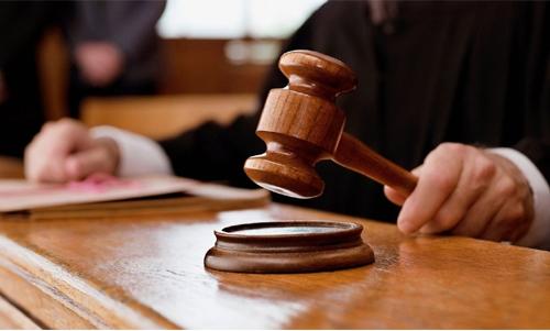 Court acquits man in fake passport case