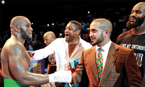 Maximos lifts African Wrestling Belt