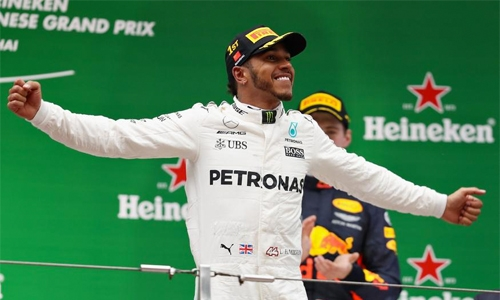 Lewis Hamilton roars to victory in Chinese Grand Prix