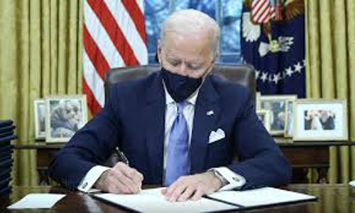 Biden scraps Muslim travel ban among series of decisions on Day 1