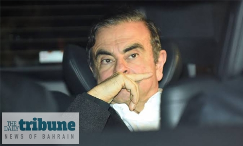 Ghosn seen on security camera leaving Tokyo home alone: media