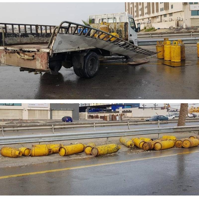 Accident leaves gas cylinders tossed across street