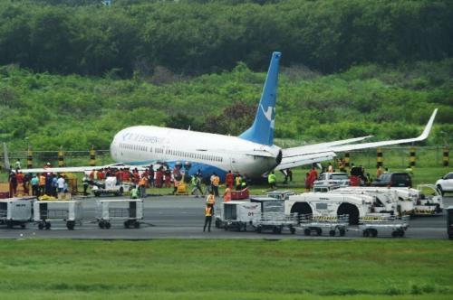Plane slides off Manila runway causing delays