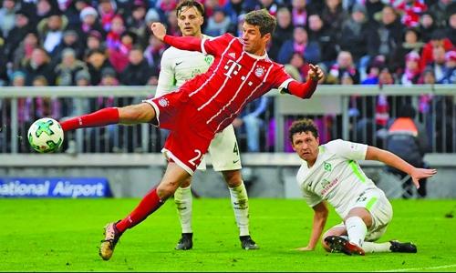 Muller reached century  in win over Bremen