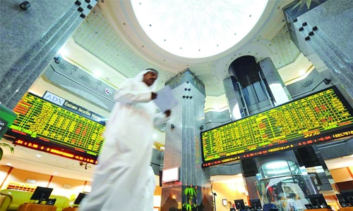 Abu Dhabi advance while region dips