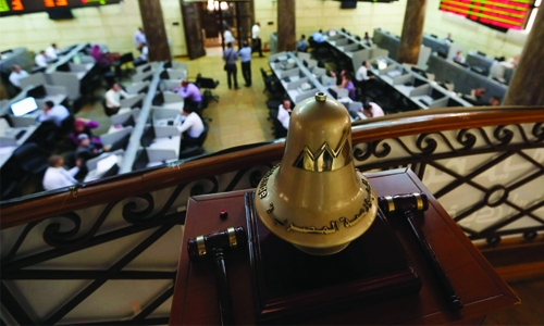 Big bank boosts Egypt as dividend cut hurts Abu Dhabi
