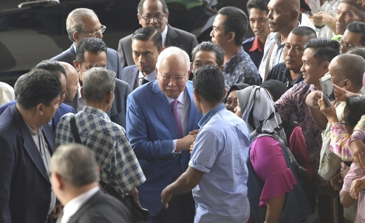 Malaysia's ex-leader Najib begins defense in graft trial