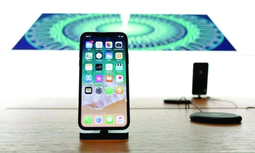 Apple shares skid on report  of iPhone X production cut