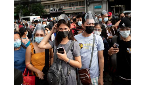 Chaos at Philippines covid vaccine sites as thousands rush to get jabs before lockdown