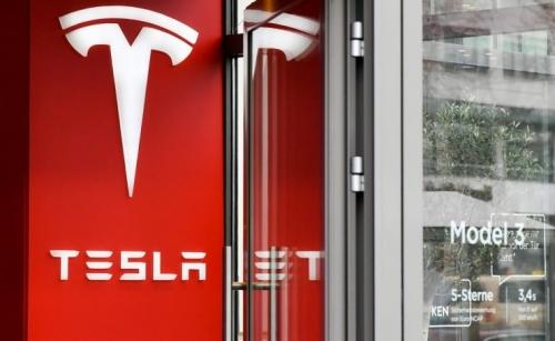 Tesla revenue beats expectations with full year of profitability
