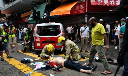 Petrol bombs, tear gas rock Hong Kong