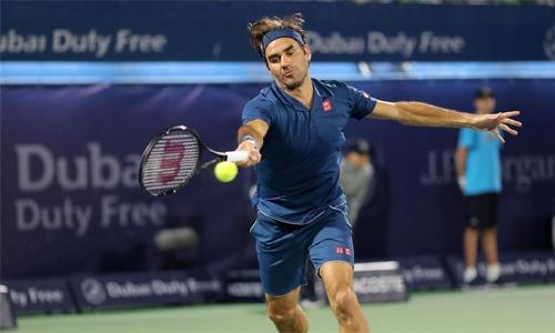 Federer fends off Kohlschreiber