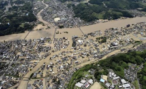 Heavy rain floods southern Japan; 2 dead, dozen missing