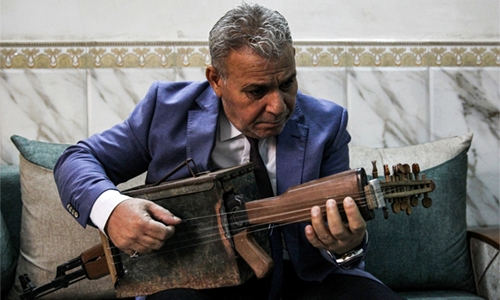 Iraqi transforms Kalashnikov into musical instrument
