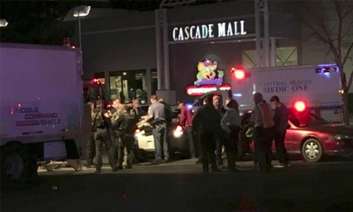 Gunman on the run after shooting dead three at Washington mall