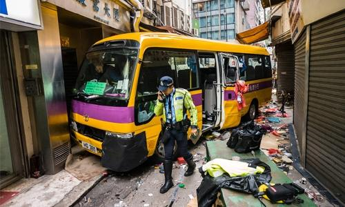 Four killed as Hong Kong schoolbus mounts pavement