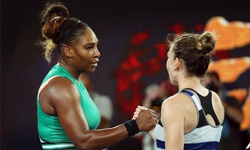 Serena outslugs Halep