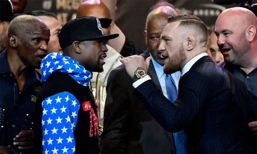Mayweather knocks out brave McGregor to win superfight