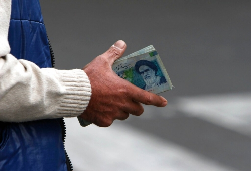 Iran's rial falls to new low, as virus deaths hit new high
