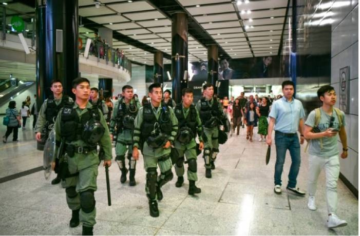 Riot police thwart Hong Kong airport protest