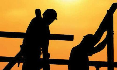 Hundreds of expat workers in construction sector continue to struggle without salaries