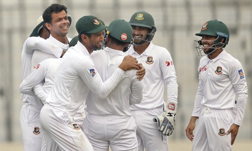 14 wickets fall on bowlers dominated day one in Dhaka