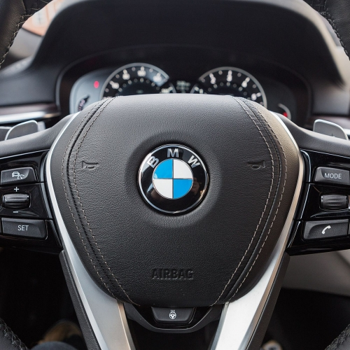 BMW cuts jobs, ends self-driving project with Mercedes