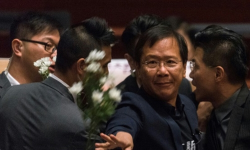 HK lawmakers dragged from chamber