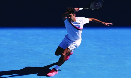 Federer powers into quarters
