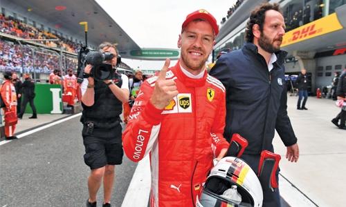 Vettel on pole as Hamilton struggles