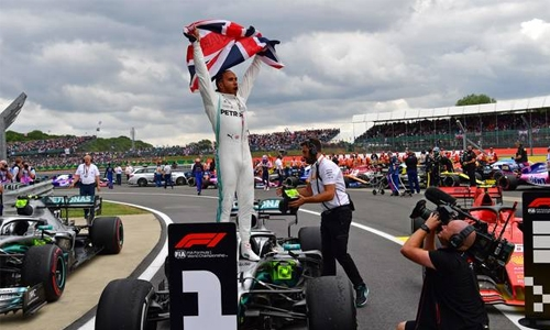 Hamilton wins record sixth British GP
