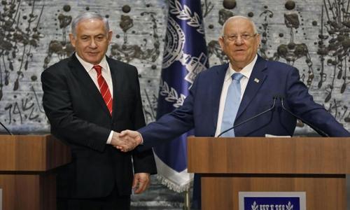 Israel's president picks Netanyahu opponent Yair Lapid to form government
