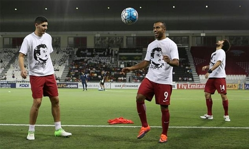 Qatar risk FIFA action after T-shirt protest