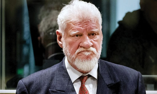 Bosnian war criminal drinks poison inside court, dies