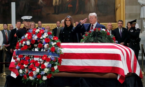 Bush remains lie in state as tributes pour in