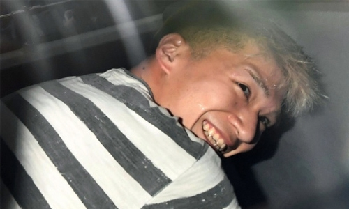Japan knife attacker grins before cameras