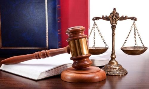 Court acquits two men in helping fugitive case