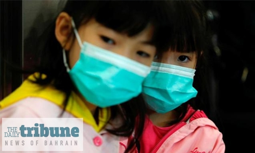 China locks down two cities to curb outbreak