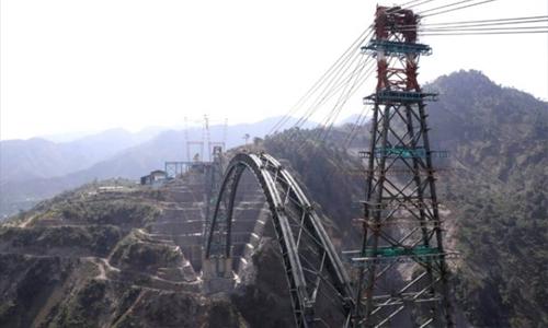 India completes arch of world's highest railway bridge