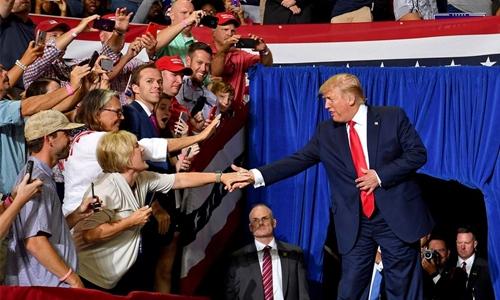 Trump fires up base as impeachment bid blocked