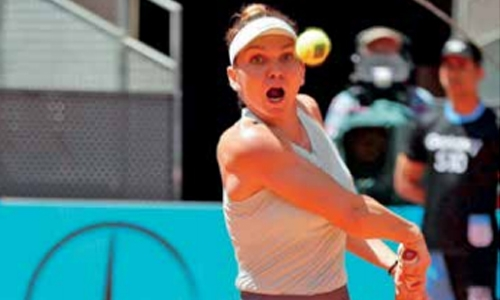 Halep passes Bencic test to keep No.1 quest alive