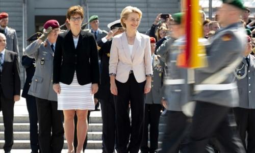 Merkel heir apparent joins cabinet in risky bid for power