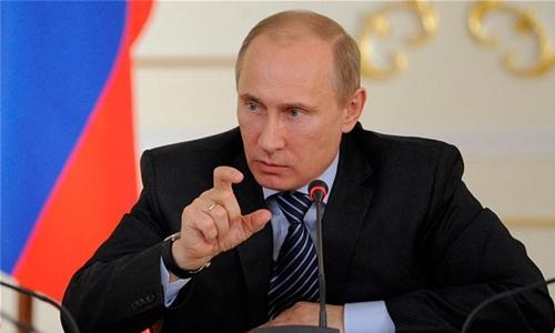 Putin vows 'symmetric response' to missile test