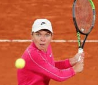 Birthday girl Halep sails through after slow start at French Open