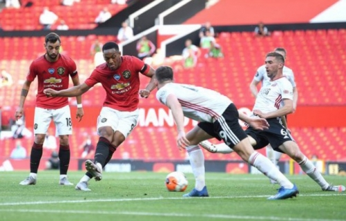 Martial hat-trick boosts Man Utd's top four hopes