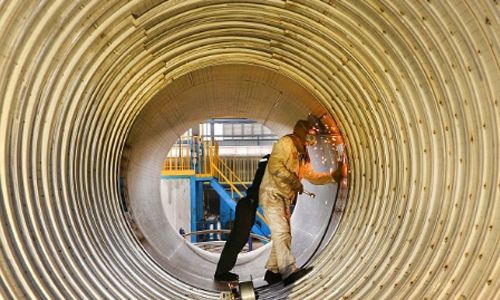 China's industrial output slows, unemployment rises