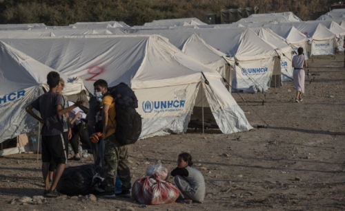Migrants move into tents after fire guts Greek camp