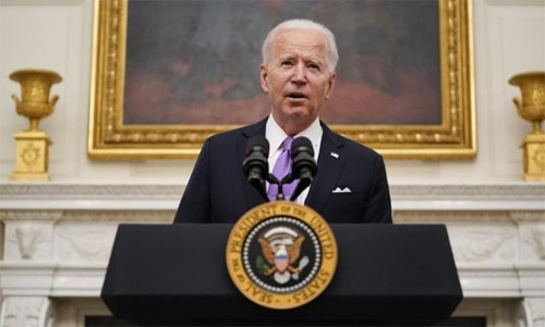 Biden signs burst of virus orders, vows 'Help is on the way'