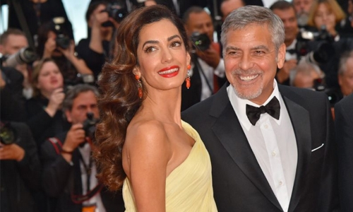 Clooney to sue Voici over images of twins